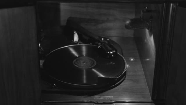 MS Shot of Record player playing record
