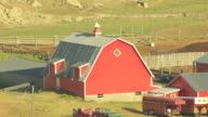 MS AERIAL Shot of red barn at farm in Teton County / Montana, United States
