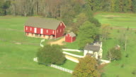 MS AERIAL ZI Shot of red farmhouse at Gettysburg National Military Park / Pennsylvania, United States