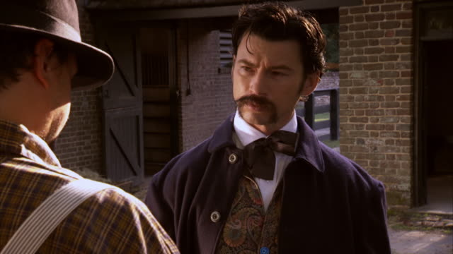 MS Shot of REENACTMENT John Wilkes Booth talking with farmer / United States