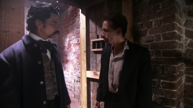 MS ZI Shot of REENACTMENT John Wilkes Booth talks with John Wilkes Booth and threatens him / United States