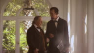 MS TS Shot of REENACTMENT President Abraham Lincoln and Vice President Andrew Johnson talking and walking / United States
