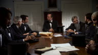 MS POV Shot of REENACTMENT President Abraham Lincoln meeting with cabinet members / United States