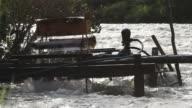 MS Shot of regional watermill at river / Campo Novo do Parecis, Mato Grossso, Brazil