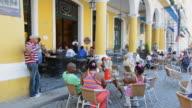 WS Shot of relaxing people in square caf̩ / Havana, Cuba