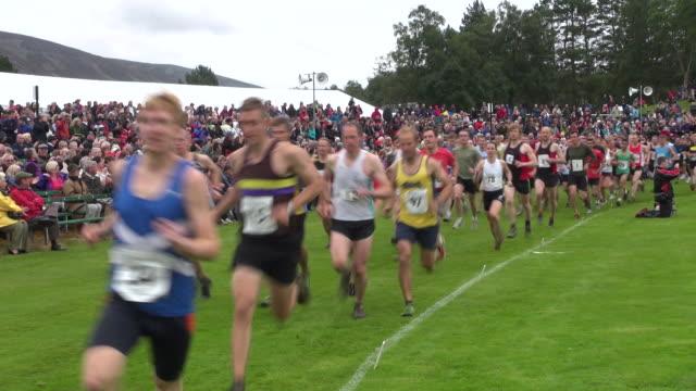 MS Shot of relay race at braemar royal highland games / Braemar, Aberdeenshire, Scotland