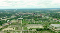 WS AERIAL Shot of remnants of Buick City with downtown Flint / Flint, Michigan, United States