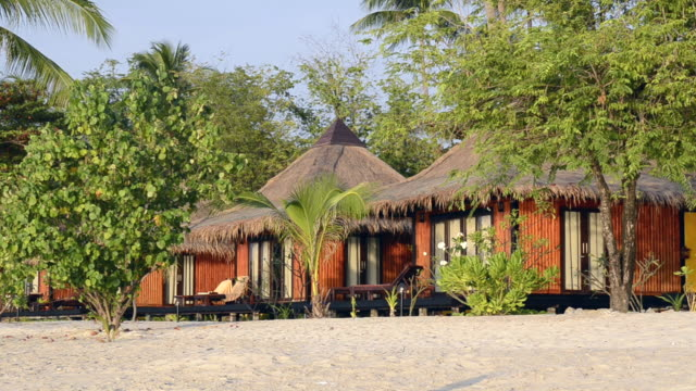 MS Shot of Resort with seaside bungalows and palm trees at sandy beach, hat chao mai marine national park / Ko Mook, Trang, Thailand