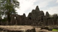 MS TD Shot of revealing ruins of Angkor Wat temple with some headless statues in courtyard / Siem Reap, Siem Reap Province, Cambodia