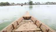 WS POV Shot of riding on water taxi to Korail slum / Dhaka, Bangladesh