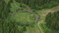 MS AERIAL ZO Shot of Ring Der Errinerung with forest / Germany
