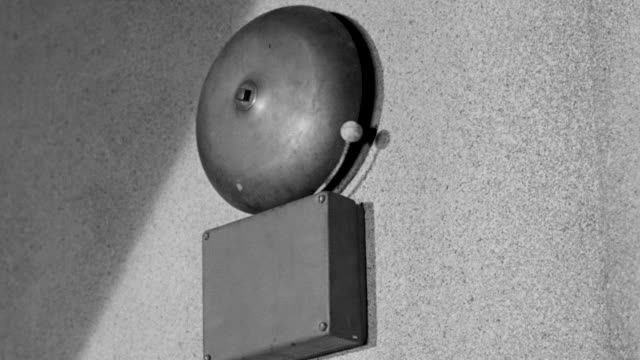 CU Shot of ringing alarm bell on wall