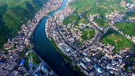 WS AERIAL shot of River By Town In Zhenyuan County ,Guizhou,China.