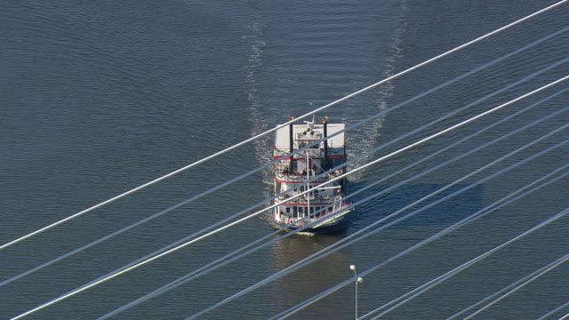 MS AERIAL ZI Shot of Riverboat Georgia Queen and bridge / Georgia, United States