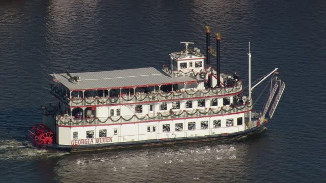 MS AERIAL CU ZO TS Shot of Riverboat Georgia Queen moving in river / Georgia, United States
