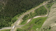 WS AERIAL Shot of road besides hoback river / Wyoming, United States