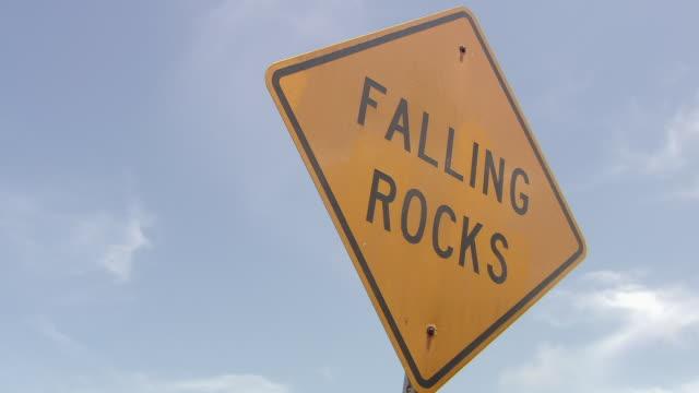 CU Shot of road sign 'Falling rock' / Maui, Hawaii, United States
