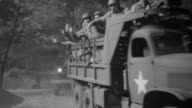 MS Shot of Road throught forest or park as military convoy passing through