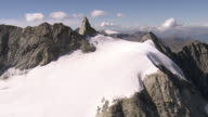 MS AERIAL Shot of rock needle and Aiguille Glacier with Mont Collon, Petit Mont Collon and Pigne de Arolla / Aiguille de la Tsa, Valais, Switzerland