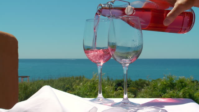 MS Shot of rose wine pouring in glass / Estepona, malaga, Spain