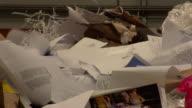 ECU Shot of Rubbish moving along conveyor belt into disposer / London, United Kingdom