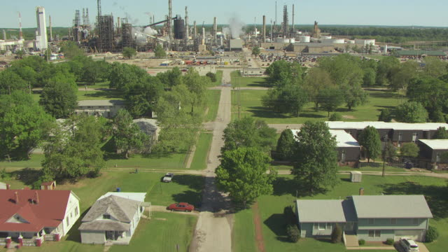 MS AERIAL Shot of ruined neighborhood at Coffeyville Resources refinery / Coffeyville, Kansas, United States