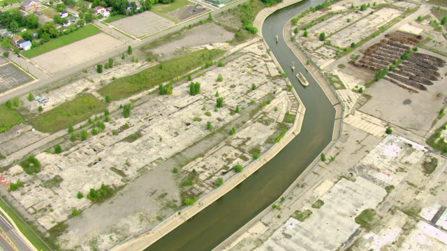CU AERIAL DS TU Shot of ruins with water ravine in downtown / Flint, Michigan, United States
