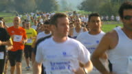 MS SLO MO Shot of runners participating in race / Hula valley, Upper Galilee, Israel