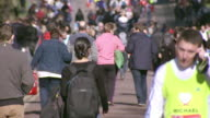 MS Shot of Runners walking to start of London Marathon / London, United Kingdom