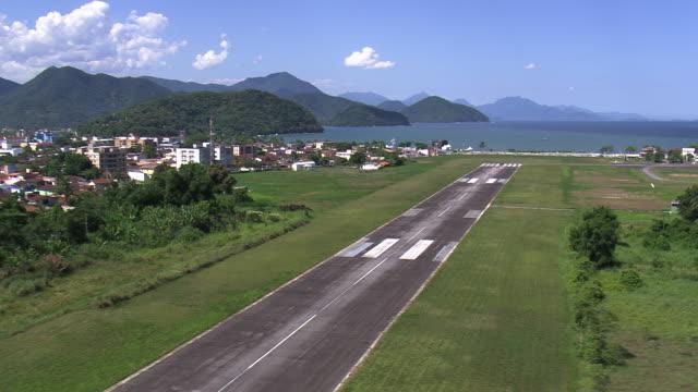 WS AERIAL Shot of runway at Ubatuba town / Sao Paulo, Brazil