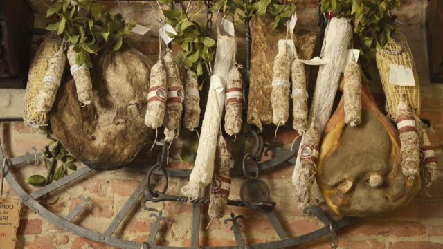 MS Shot of Salami and ham in tuscany delicatessen store / Montepulciano, Tuscany, Italy