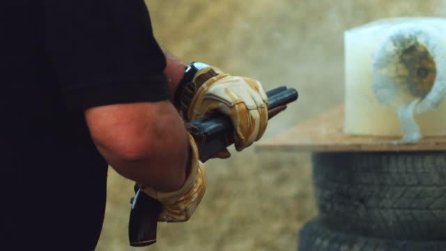 CU SLO MO Shot of sawn off shotgun being fired / United Kingdom