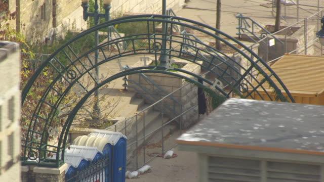 CU AERIAL ZO Shot of Schlitz Park iron arch entrance / Milwaukee, Wisconsin, United States