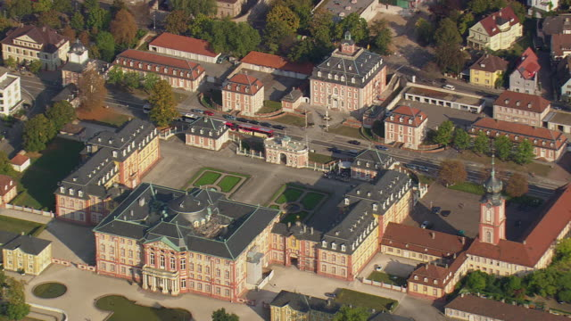 MS AERIAL Shot of Schloss Bruchsal with garden and other buildings / Germany