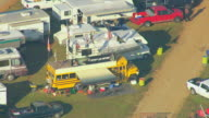 MS AERIAL Shot of school bus at tailgating at Talladega Superspeedway / Lincoln, Alabama, United States