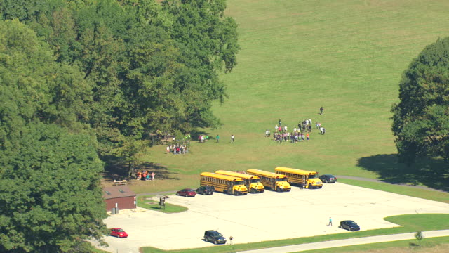 MS AERIAL Shot of school buses with students on parking lot at Valley Forge National Park and landscape with National Memorial Arch / King of Prussia, Pennsylvani,a United States