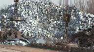 MS Shot of scrap depot at steel mill / Bous, Saarland, Germany