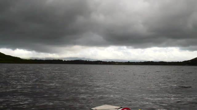 WS POV Shot of sea and storm clouds from boat / Dublin, Republic of Ireland, Ireland