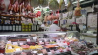 MS Shot of Seller in Butcher shop with delicatessen in Ambrogio market / Florence, Tuscany, Italy
