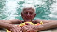 CU Shot of senior man in pool / Ubud, Bali, Indonesia