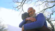 MS LA PAN Shot of Senior mixed race  couple embracing in garden / Cape Town, Western Cape, South Africa