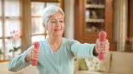 LD shot of senior woman exercising at home
