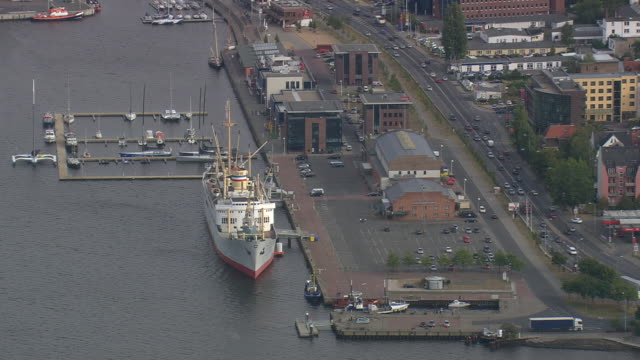 MS AERIAL Shot of ship and yacht at Rostock port / Germany