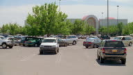 WS PAN Shot of shopping mall parking lot with some cars