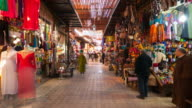 MS T/L Shot of shops at Marrakesh market 'souq as Smarrine' with people moving / Marrakech, Morocco