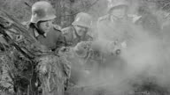 MS Shot of Shot over soldiers in trench who get hit with explosion