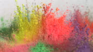 CU SLO MO Shot of showing multiple holi colors splashing up / Munich, Bavaria, Germany