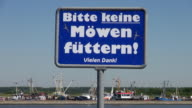 MS Shot of sign board (don't feed seagulls), North Sea North Frisia, / Tonning, Schleswig Holstein, Germany