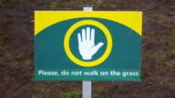 CU Shot of sign please do not walk on grass at Keukenhof Gardens / Lisse, South Holland, Netherlands