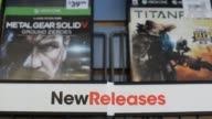 Shot of signage inside a GameStop Store in Peru Illinois of the NEW RELEASES and USED GAMES sections Shots of new XBox 360 games on sale including...